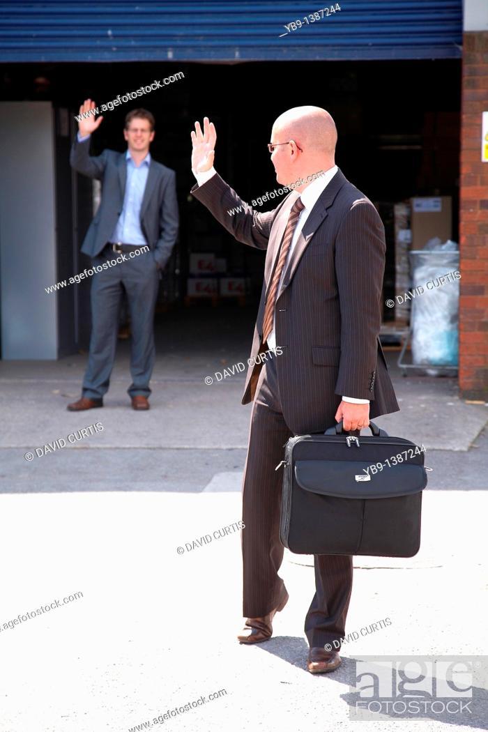 Stock Photo: Businessman waving goodbye after meeting.