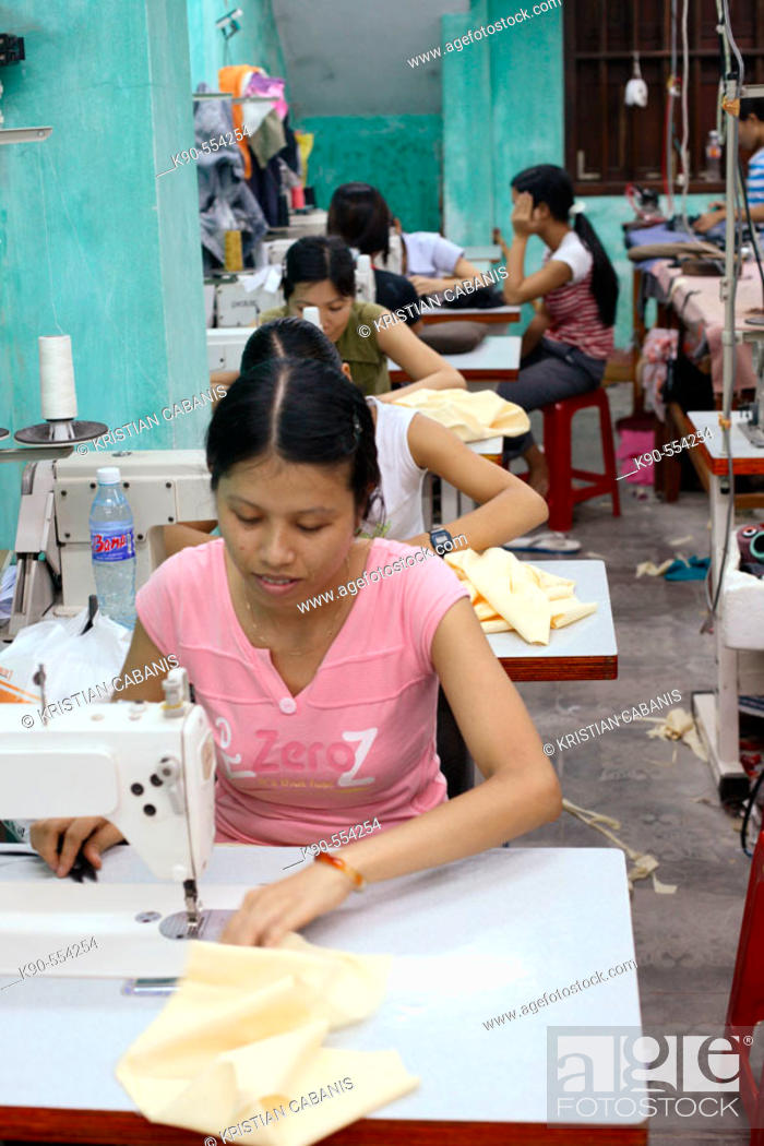 Small garment factory where workers make shirts by hand, Hoi An