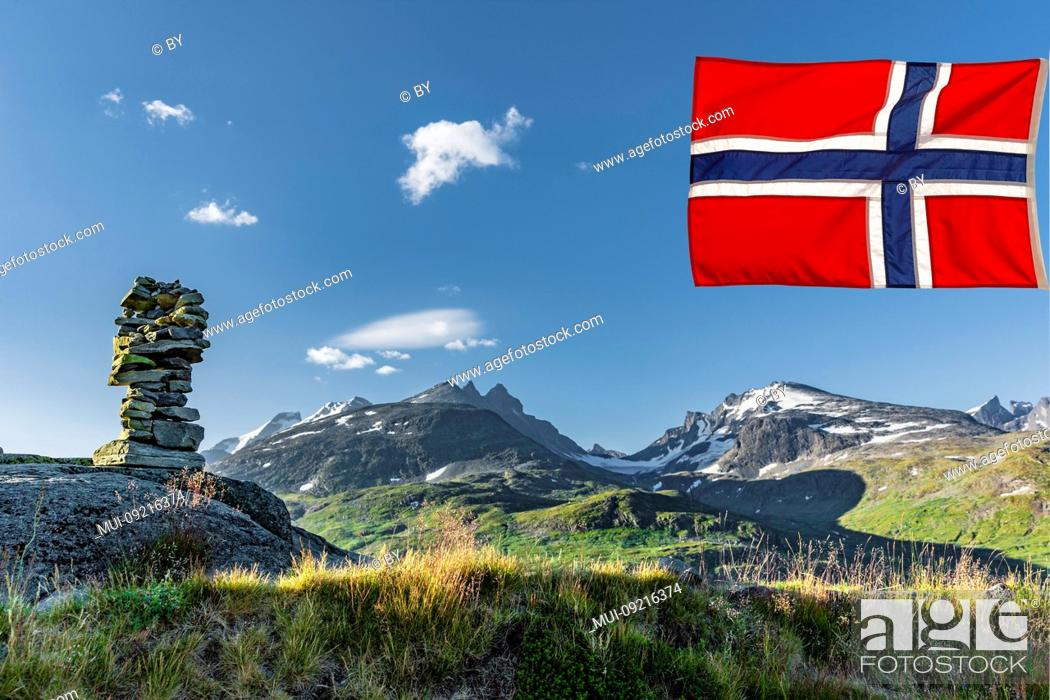 Stock Photo: Mountain landscape with stone pyramid in Jotunheimen with Norwegian flag.
