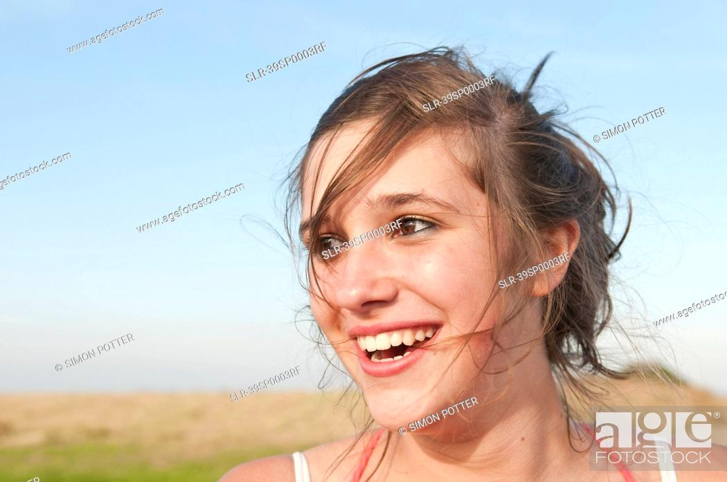 Stock Photo: Close up of girl?s smiling face.