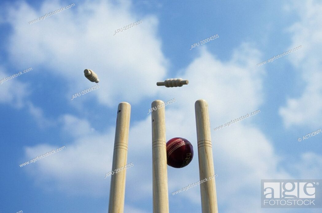 Stock Photo: Close up of a cricket ball striking a wicket.