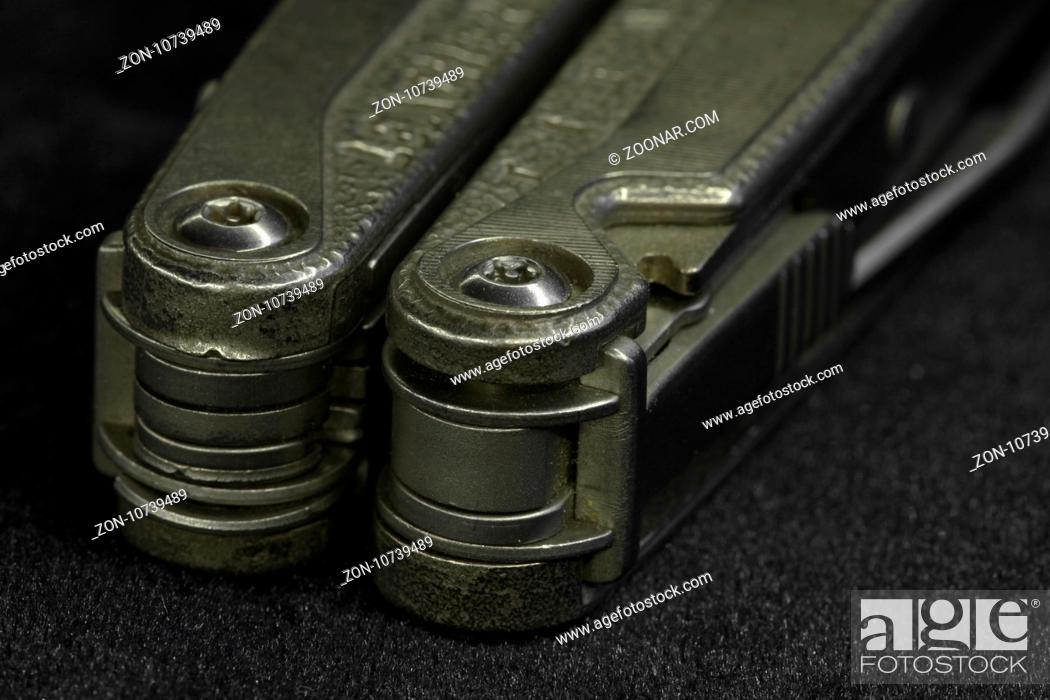 Stock Photo: multitool Steel knife macro shot.