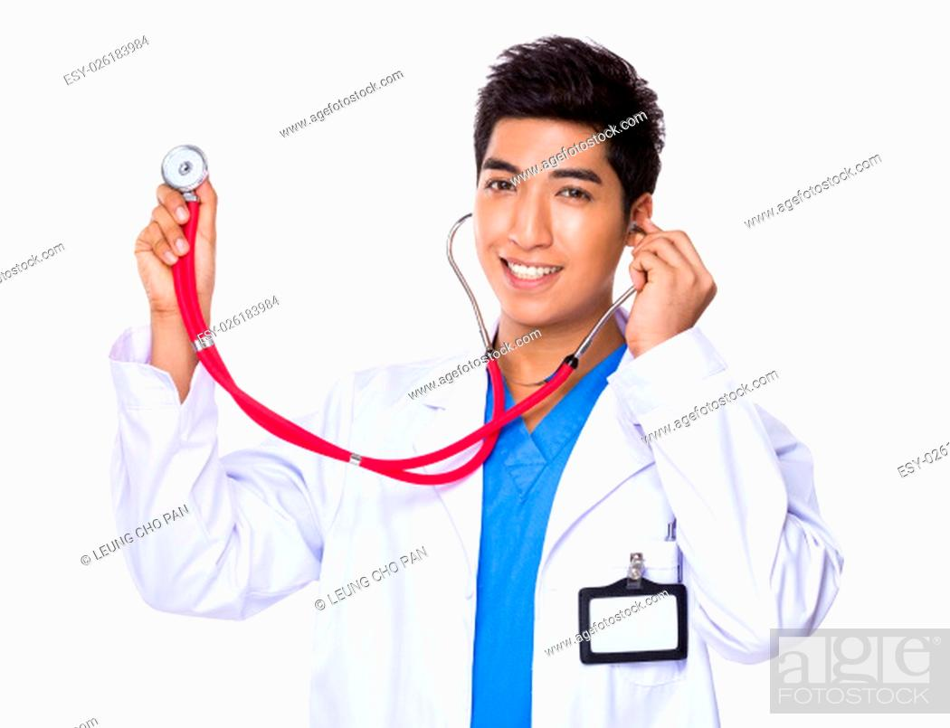 Stock Photo: Doctor man use of the stethoscope.