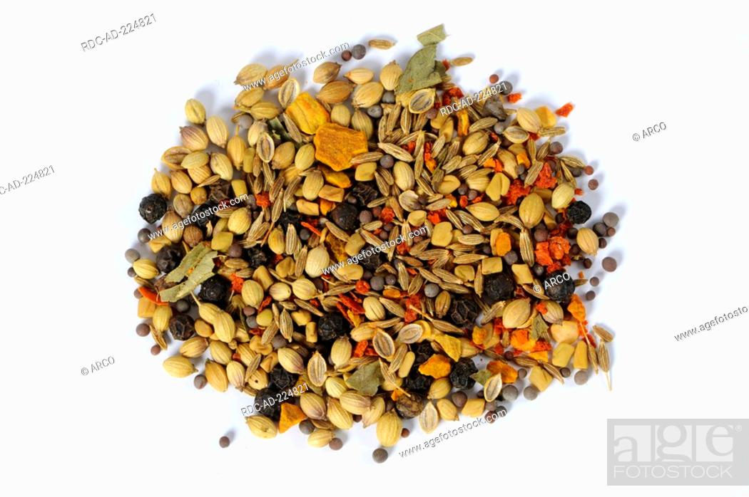 Stock Photo: Curry ingredients, turmeric, cumin, coriander, mustard seed, chilli, black pepper and curry leaves.