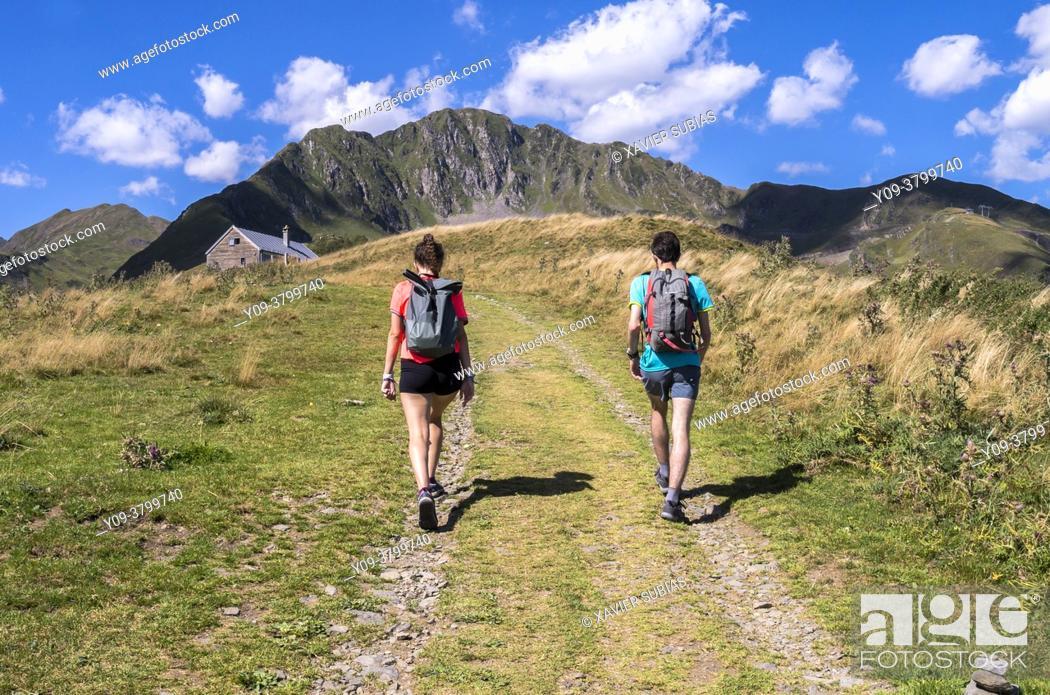 Stock Photo: Hikers, Pyrenees Superbagnères, Bagnères-de-Luchon, Haute-Garonne department, Occitanie, France.