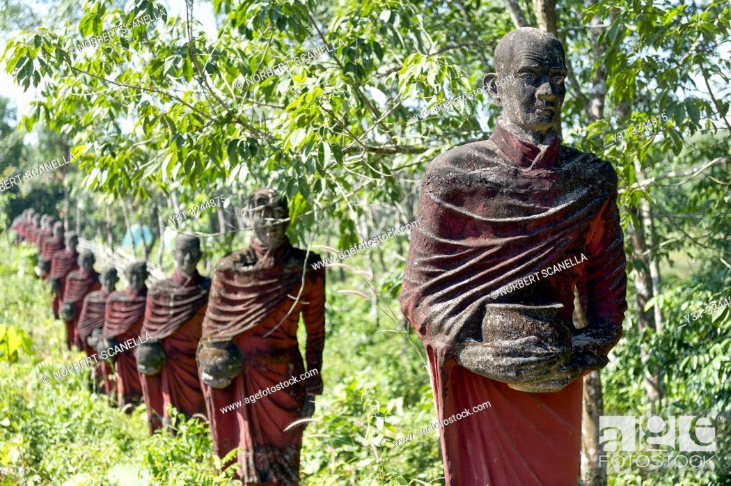 Stock Photo: Myanmar (formerly Burma). Mon State. Yadana Daung Mawlamyine (Moulmein) surroundings, Win Sein Taw Ya temple. Row of statues of the 500 Arahant followers of.