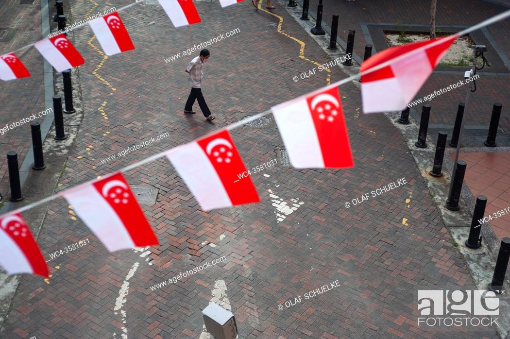 Stock Photo: Singapore, Republic of Singapore, Asia - Elevated view of little flags in the national colours of the city-state that waver as pennant banners above a road and.