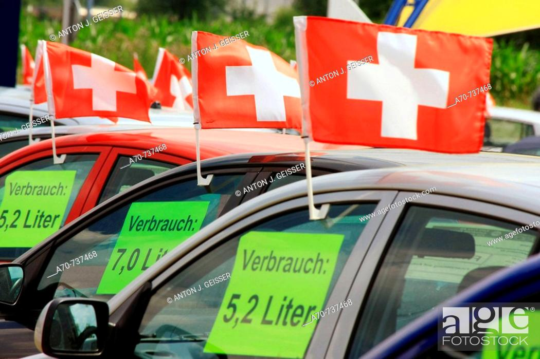 Stock Photo: Used cars for sale, signs showing fuel consumption. Switzerland.