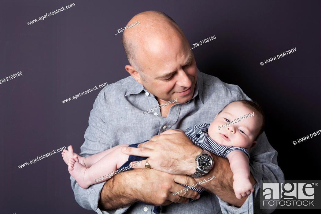 Stock Photo: Father holding his baby son.