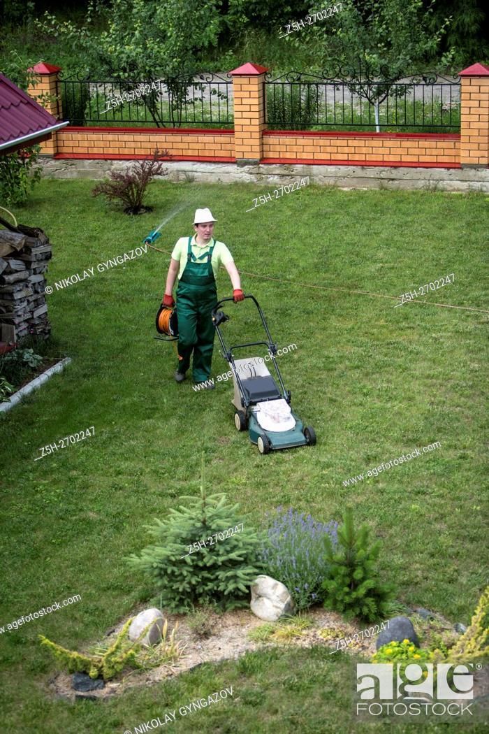 Stock Photo: Russia. Belgorod region. Young man in the summer garden.