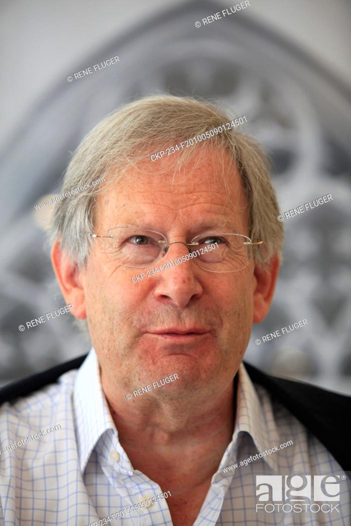 Stock Photo: Famous British conductor sir John Eliot Gardiner answers questions at a press conference ahead of his evening concert with English Baroque Solists orchestra and.