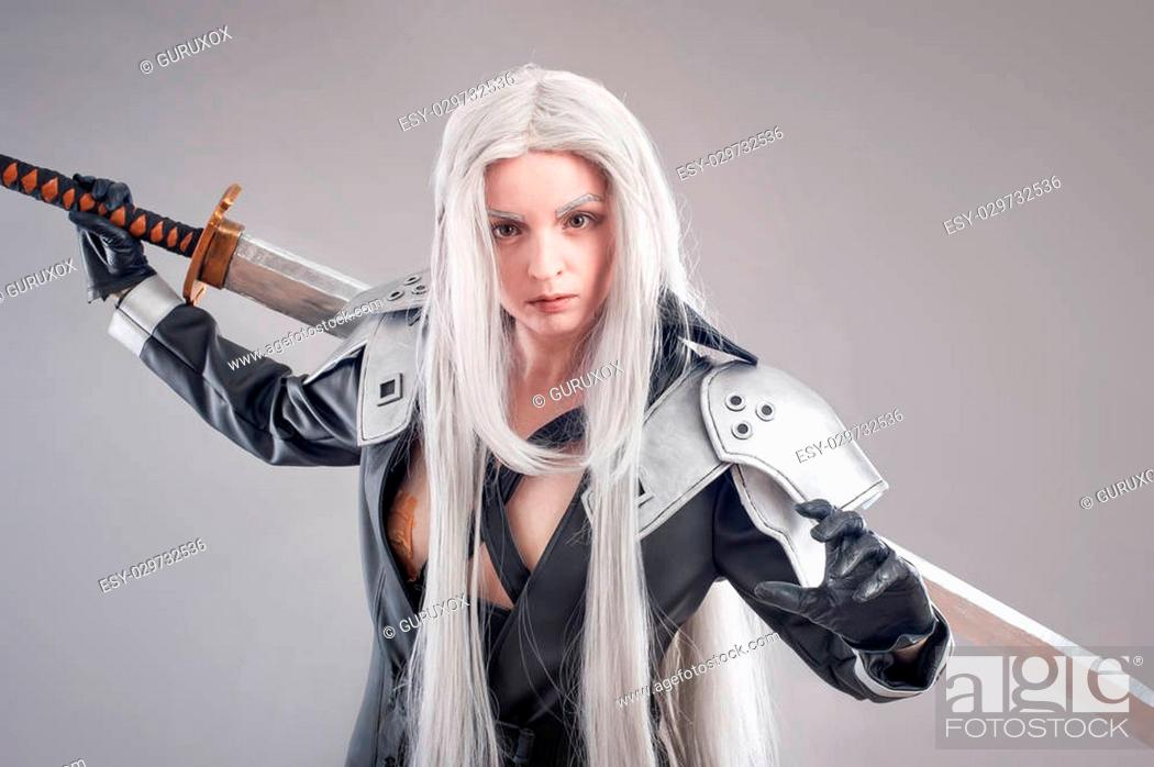 Stock Photo: Woman warrior with sword and armor isolated on the gray background.