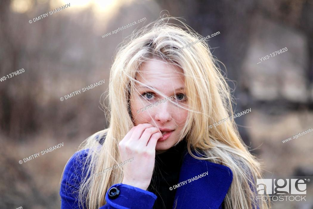Stock Photo: Portrait of beautiful woman in autumn outdoors in blue coat.