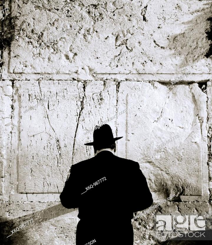 Stock Photo: An religious orthodox Jewish man at the Wailing Western Wall in Jerusalem in Israel in the Middle East.