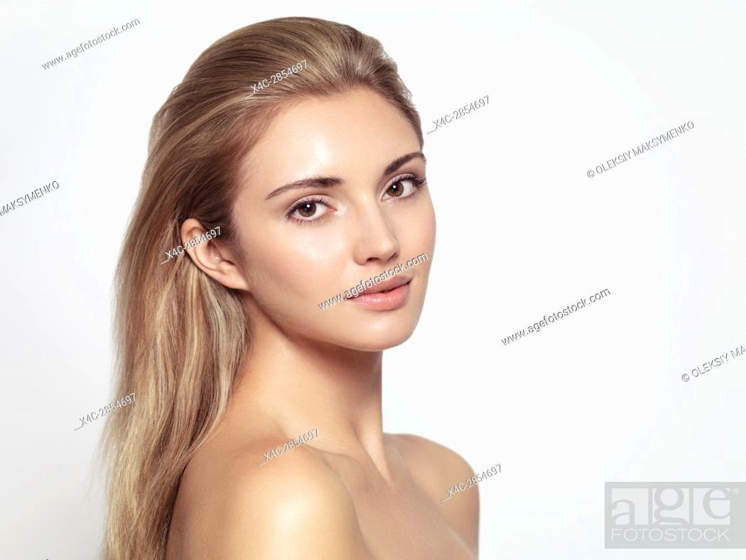 Stock Photo: Beauty portrait of a young beautiful woman face with long light brown blond hair, exotic sensual look and clean glowing skin isolated on white background.