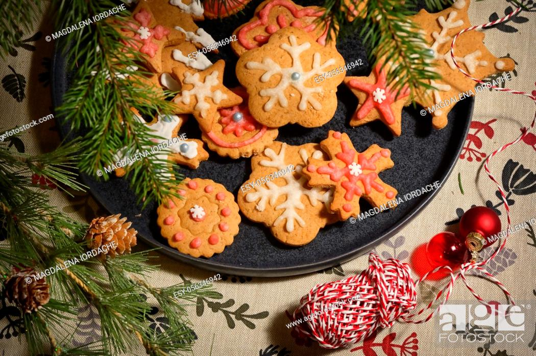 Stock Photo: Gingerbread Christmas Cookie on Plate and Pine Brunches.