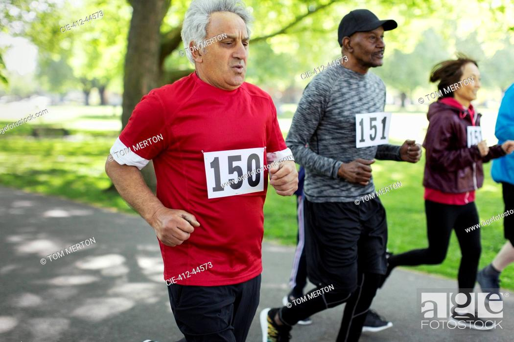 Stock Photo: Active senior man running sports race in park.
