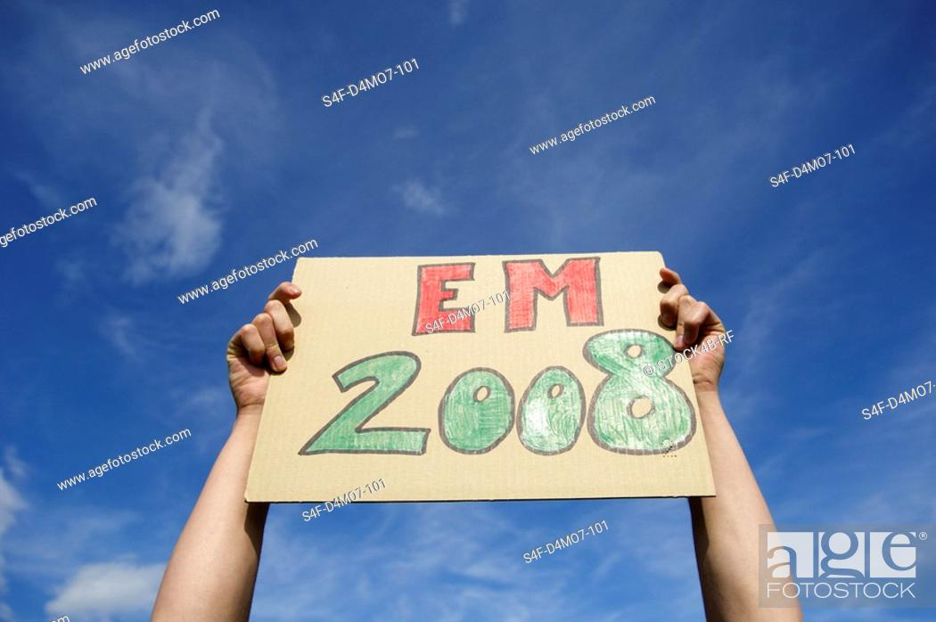 Stock Photo: Hands holding EM 2008 sign up.