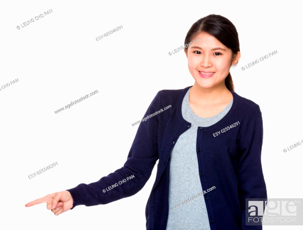 Stock Photo: Young asian woman pointing a direction.