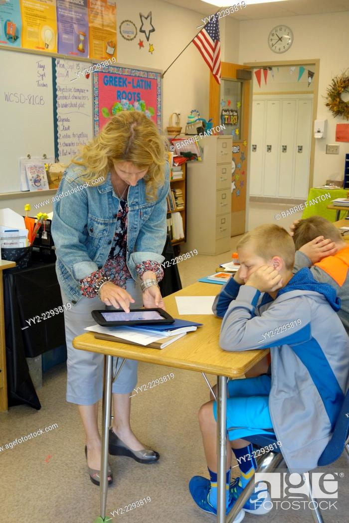 Stock Photo: Teacher Assisting Student.