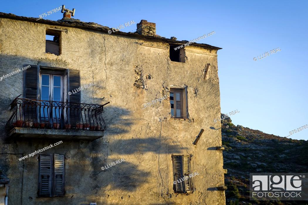Stock Photo: achada de una casa tipica de pueblo al atardecer, Santo-Pietro-di-Tenda, Cosega, France.