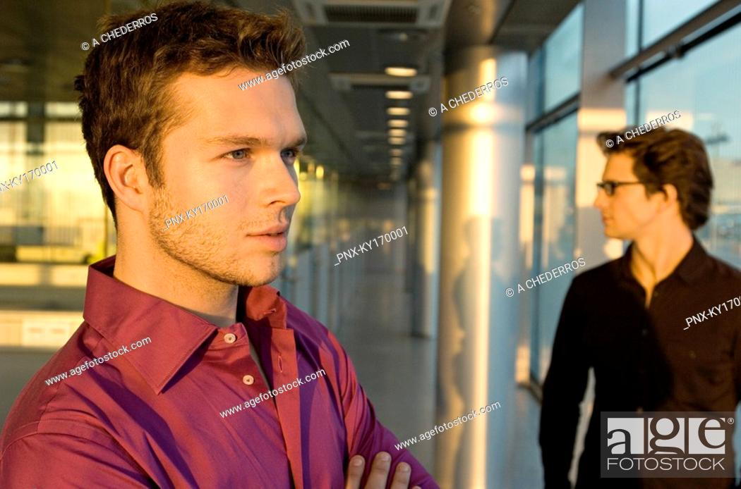 Stock Photo: Close-up of a businessman with another businessman standing behind him.