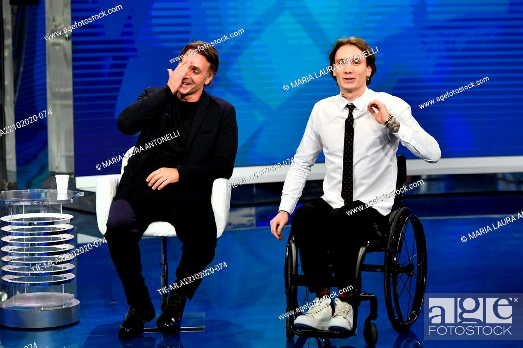 Stock Photo: The actor Raoul Bove surprised by the presence in the tv studio of the swimmer Manuel Bortuzzo with which he will make a film , Rome, ITALY-21-10-2020.
