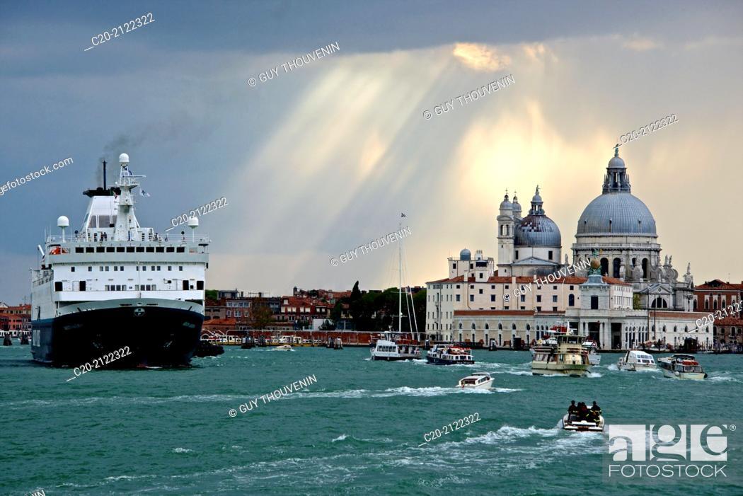 Stock Photo: Punta della Dogana, and Santa Maria della Salute church behind, with liner cruise boat and boats, Venice, Italy.