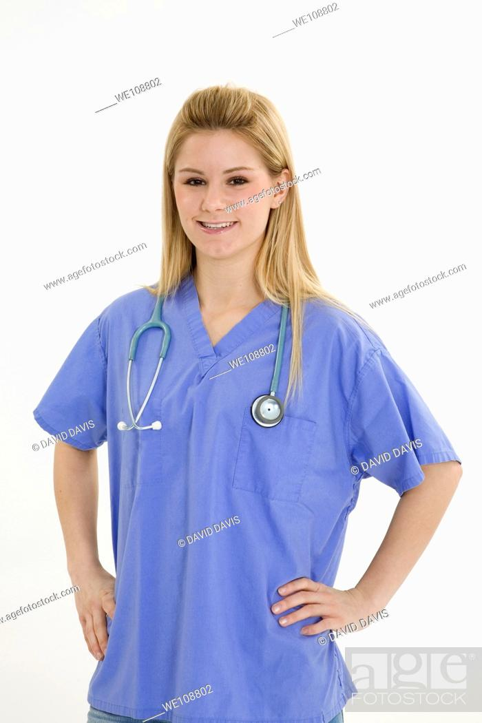 Stock Photo: Young caucasian female nurse wearing scrubs outfit.