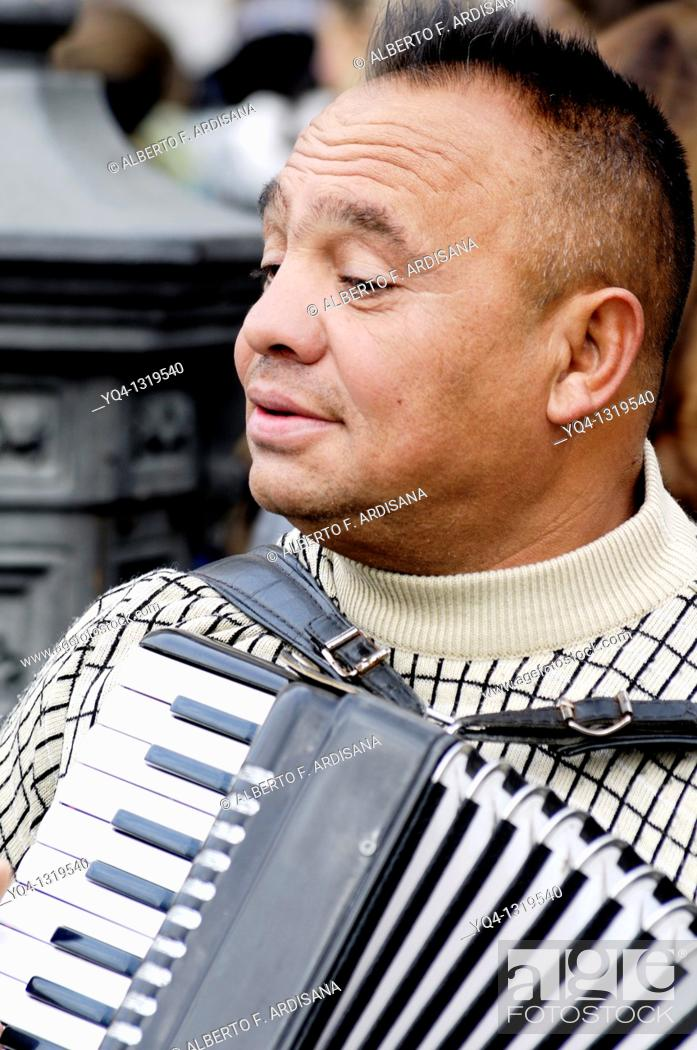 Stock Photo: Accordion playing in the streets of Madrid.