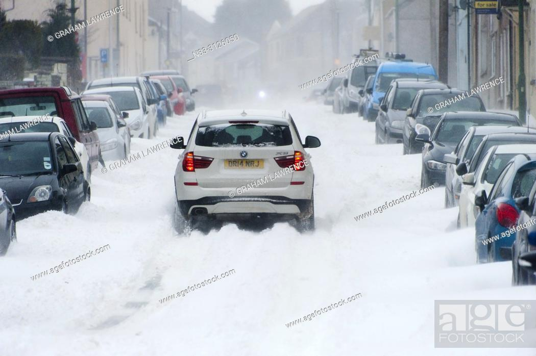Stock Photo: A blizzard hits the town of Brynmawr in Blaenau Gwent, Wales, UK in early March 2018.