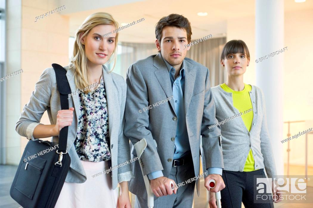 Stock Photo: Disabled businessman standing with two women.