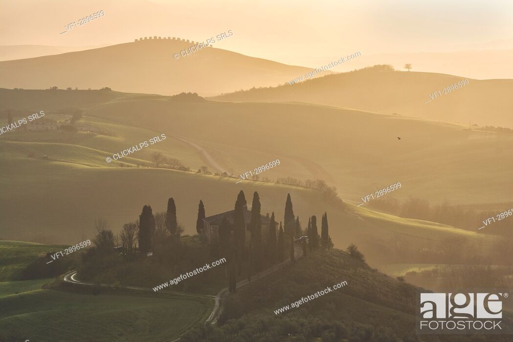 Stock Photo: Sunrise in Val d'Orcia, Siena province, Tuscany district, Italy.