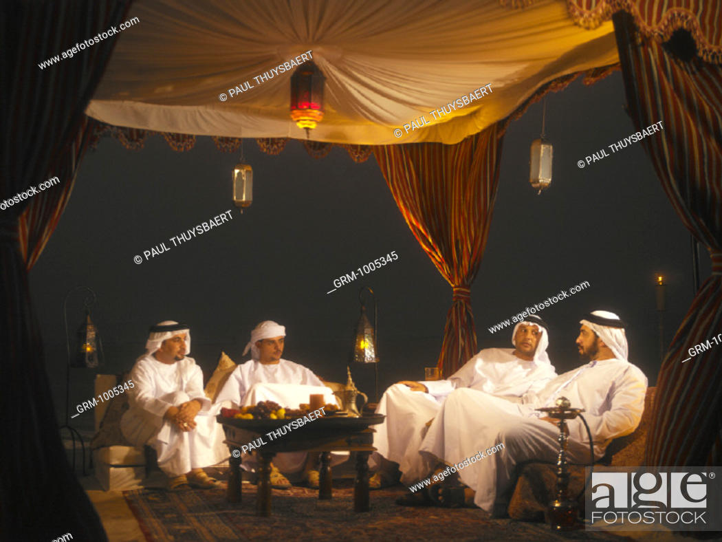 Stock Photo: Ramadan: men sitting in Arabian tent for Iftar (fast-breaking meal after sunset).