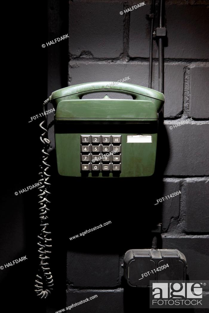 Stock Photo: A old-fashioned telephone on a wall.