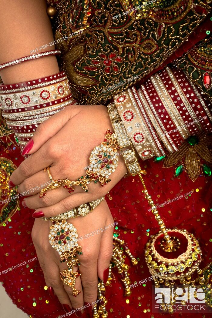 Stock Photo: Indian bride in traditional wedding dress.