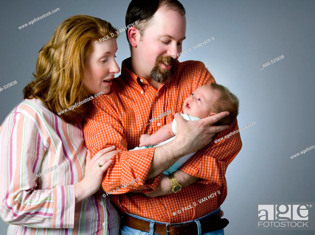 Stock Photo: New parents looking at their child.