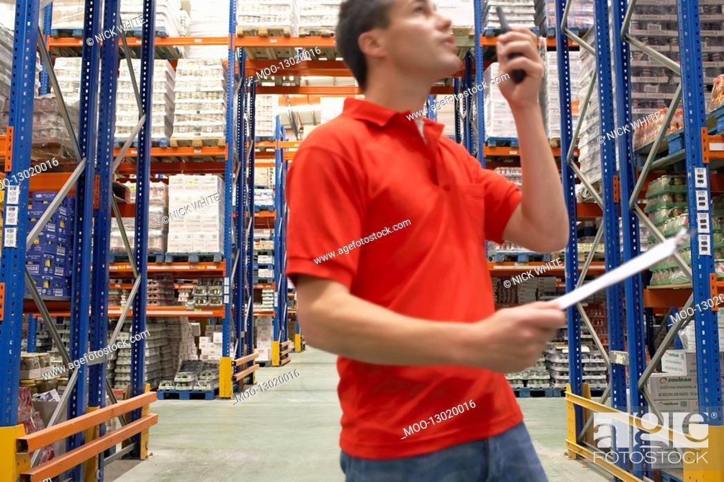 Stock Photo: Warehouse Worker Using Walkie-Talkie.