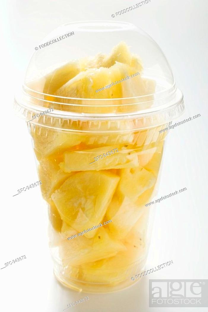 Stock Photo: Pineapple chunks in a plastic cup with a lid.