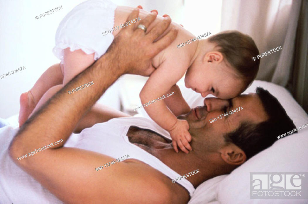 Stock Photo: Father holding his baby boy.