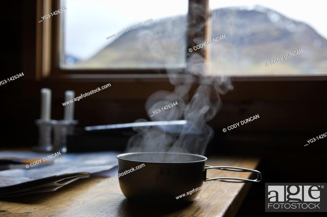 Stock Photo: Hot soup steams from titanium camping pan in mountain hut, Kungsleden trail, Sweden.