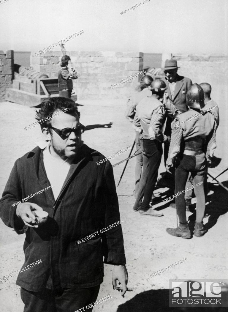 Stock Photo: Orson Welles directing the 1952 film, 'Othello'. He was filming the ramparts and cannons of the Portuguese Fort at Nagador, Morocco.