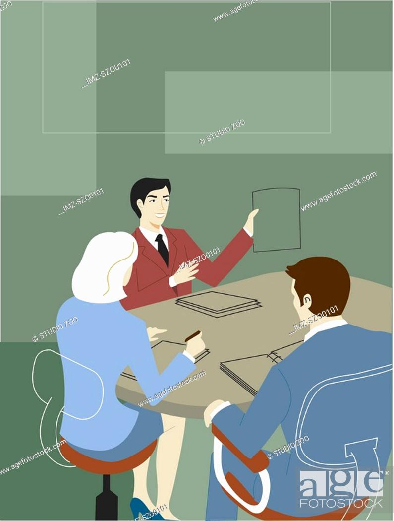 Stock Photo: Businessman giving a pitch at a meeting.