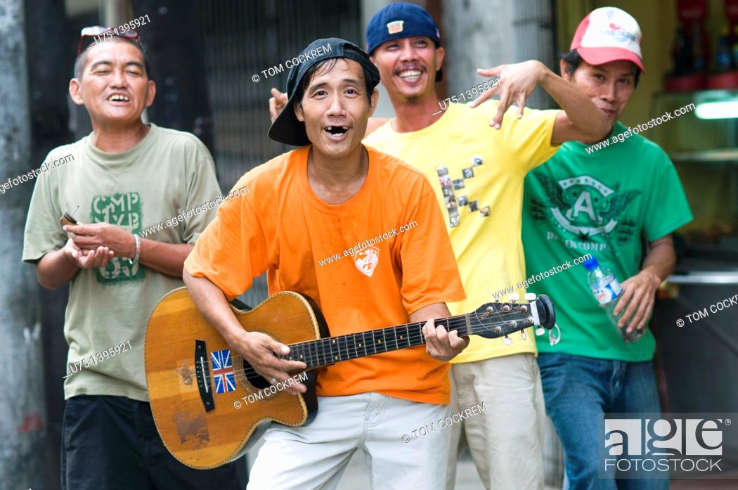 Stock Photo: men having fun, cebu city, philippines.