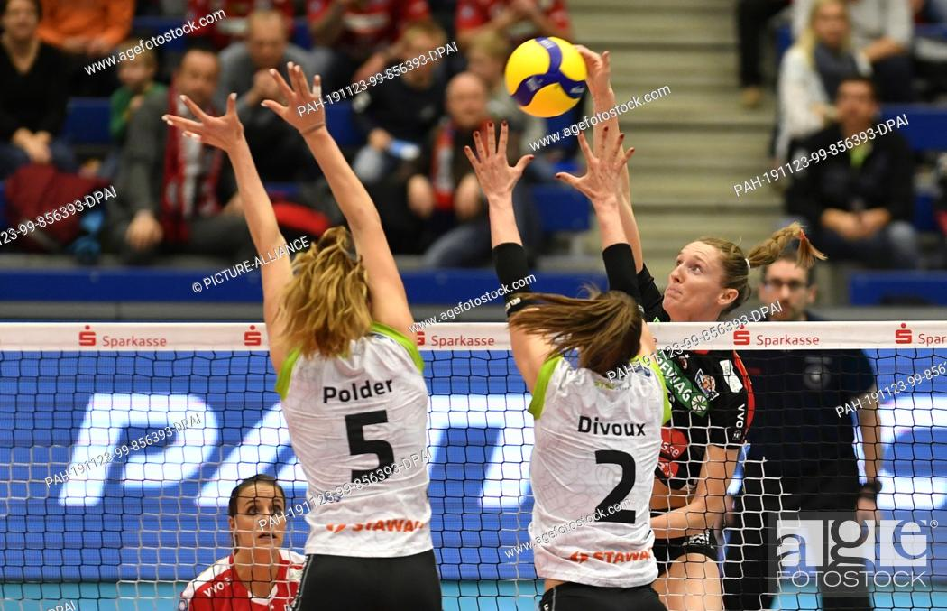 Stock Photo: 23 November 2019, Saxony, Dresden: Volleyball, women: DVV Cup, Dresdner SC - Ladies in Black Aachen. Dresden's Kadie Rolfzen (rear).