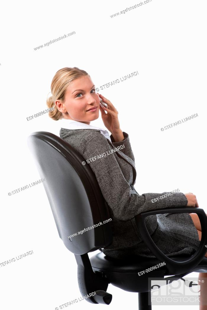Stock Photo: Beautiful young business woman working talking on the phone.