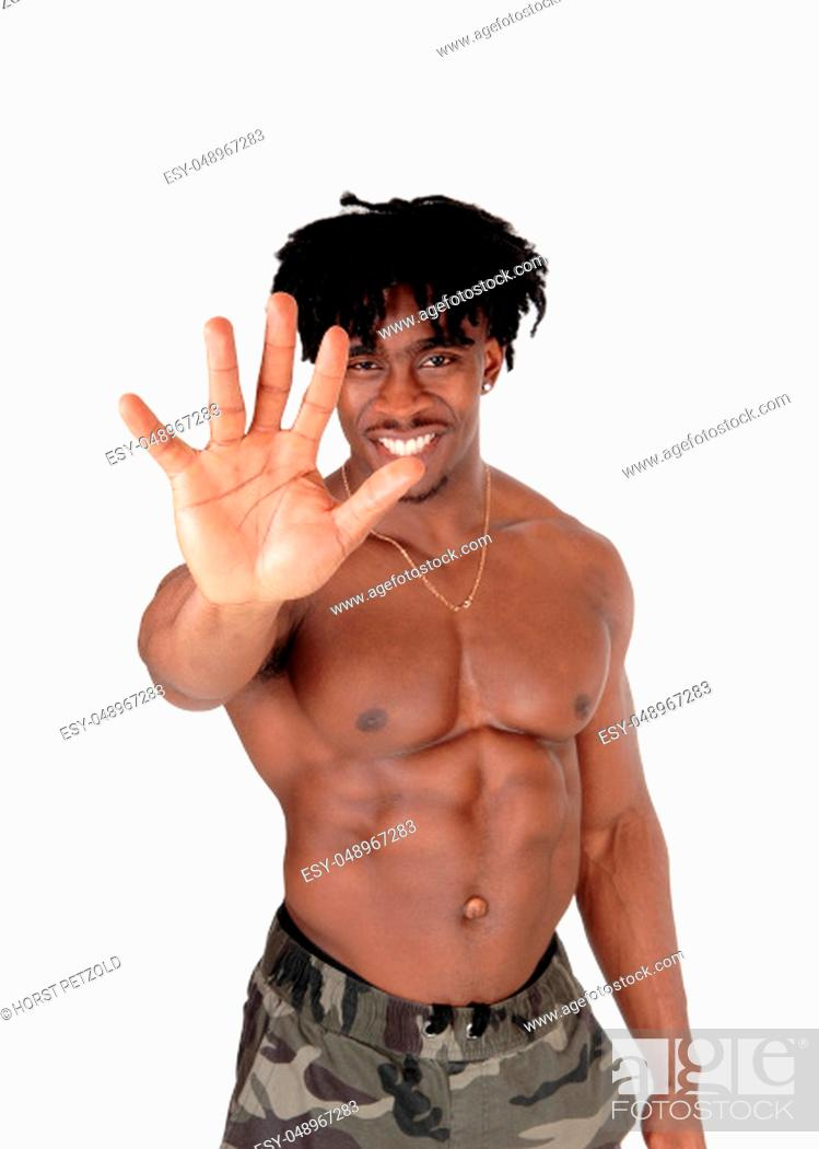 Stock Photo: A happy young African American man standing shirtless in the studio.holding his hand and saying no thanks, isolated for white background.