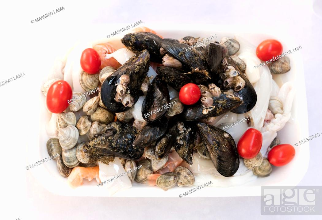 Stock Photo: fish soup ingredients: mussels, cuttlefish, clams, crock fish.
