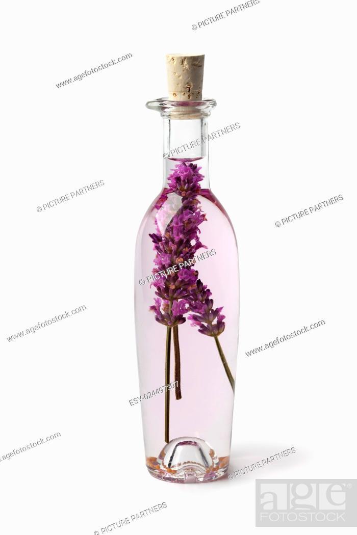 Photo de stock: Bottle with lavender vinegar on white background.