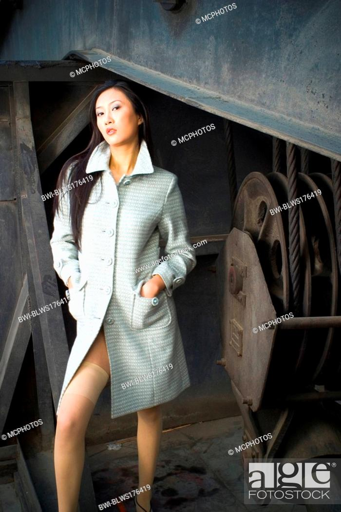 sexy asian model in grey coat and stockings stock photo picture and rights managed image pic bwi blws176419 agefotostock 2